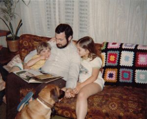 Me with my dad, little brother David, and our dog, Hector.